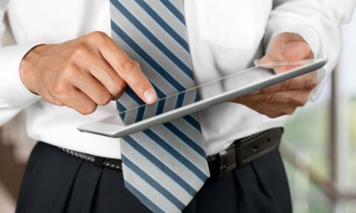 businessman board member using iPad tablet with board portal