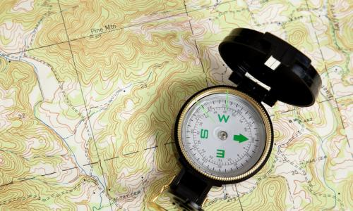 compass on a map signifying guidance