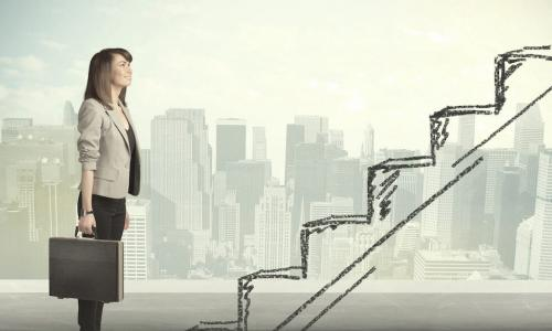 working woman standing in front of stairs drawn in pencil