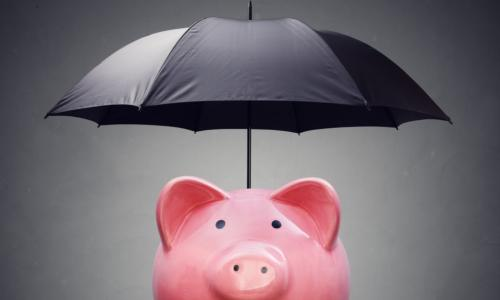 piggy bank with umbrella denoting bond insurance