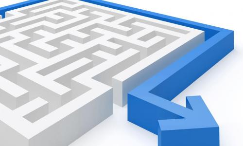 blue arrow going around the edge of a white maze showing the easy way to business banking