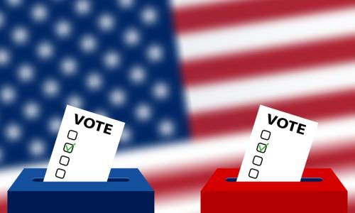 red and blue ballot boxes with an American flag in the background