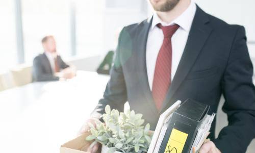 fired man leaving office with box