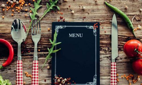 menu as part of a placesetting on a table
