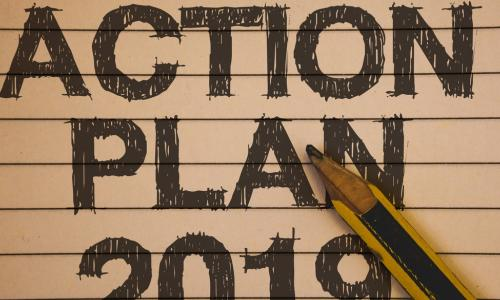 action plan 2019 scribbled on a notebook with a pencil