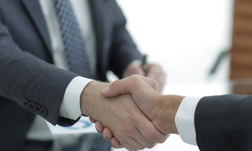 shaking hands with newly hired or promoted executive