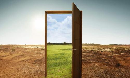 door from a dry climate opening to a greener climate