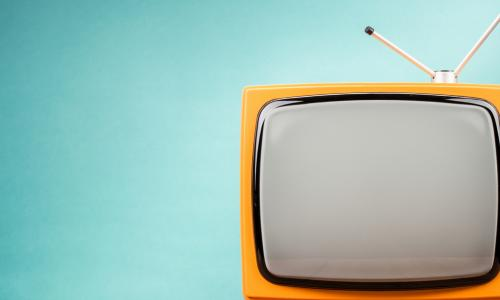 yellow television with antenna