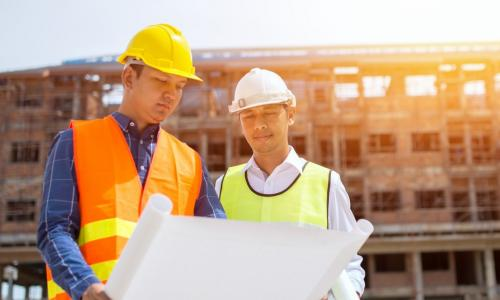 Architect and contractor reviewing plans during a construction project