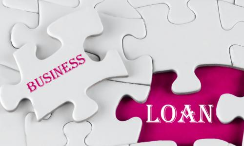 White puzzle with void in the middle when one piece of the puzzle is taken out with text written Business Loan