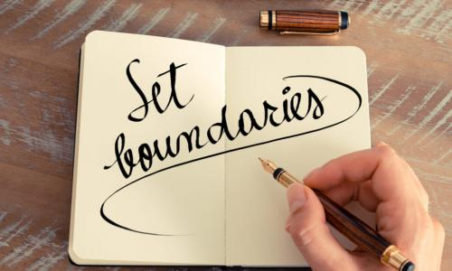 hand writing Set boundaries in a notebook with a fountain pen