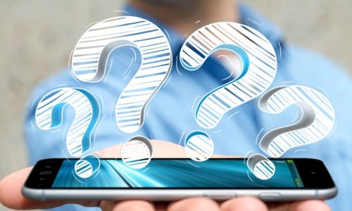 man holding smart phone with question marks above it