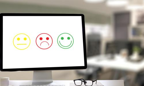 computer displaying yellow neutral green happy and red sad smiley faces