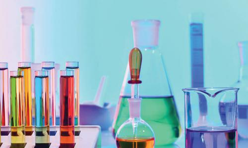 colorful vials of liquid and chemistry equipment