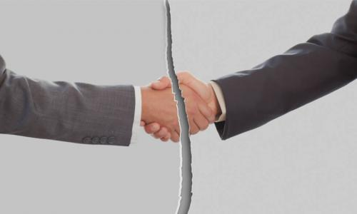 broken or torn image of businessmen shaking hands