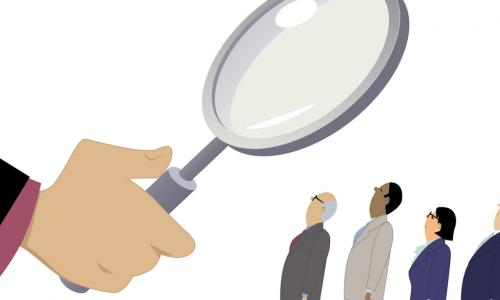 magnifying glass assessing leaders