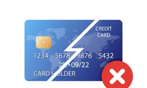 declined credit card cut in half diagonally with a red X in the corner