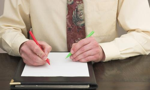 Ambidextrous Businessman working with both hands