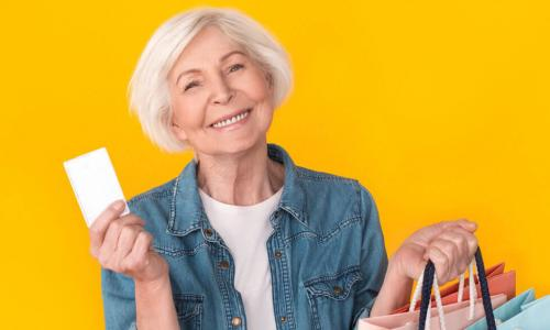 happy senior woman shopping with credit card