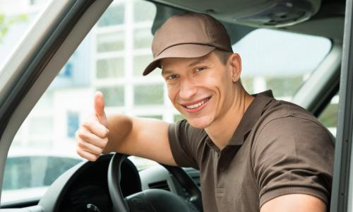 delivery man thumbs up in van