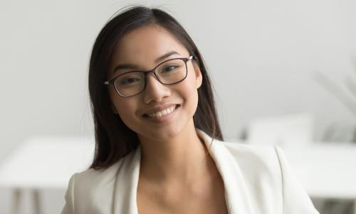smiling engaged young female employee of Asian descent