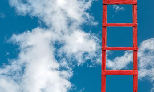 red ladder climbing into the clouds