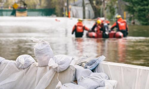 sand bags and flood rescue personnel