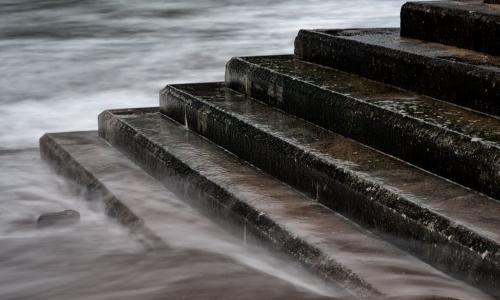 tide rising to cover stone stairs