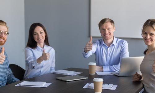 young-executives-table-thumbs-up