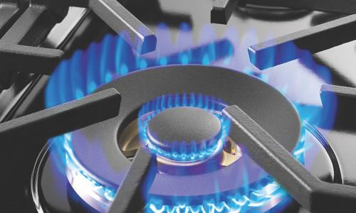 a blue flame on a stovetop burner