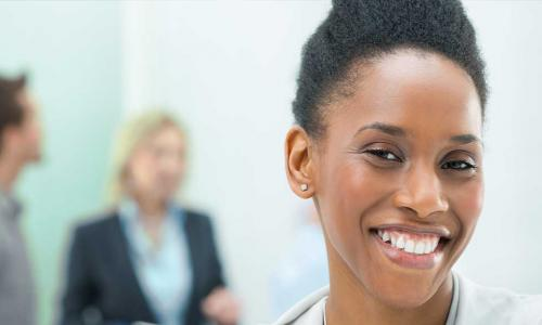 Confident young black female leader smiling