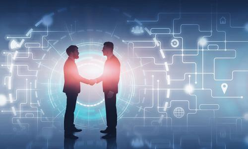 two businessmen shaking hands in front of glowing digital background