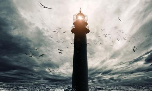 lighthouse shining over stormy seas