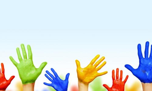 colorful painted hands raised to indicate consensus