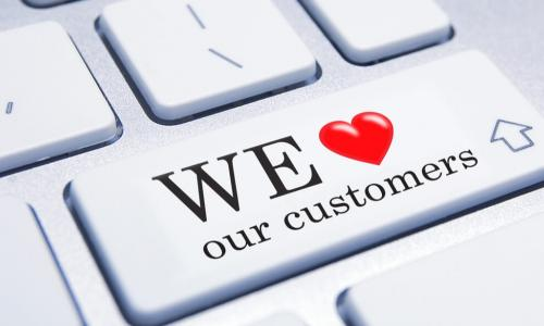 keyboard with buttons saying we love our customers