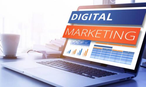 the words digital marketing popping out of a laptop screen
