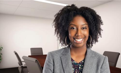 Young African-American executive smiling in the board room