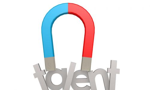 red and blue magnet sticking to metal letters spelling talent
