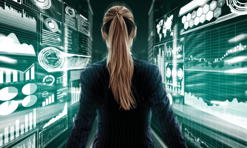 female business executive surrounded by digital dashboards