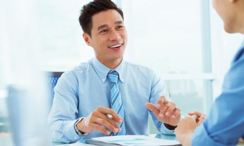 smiling engaged employee advises customer in office