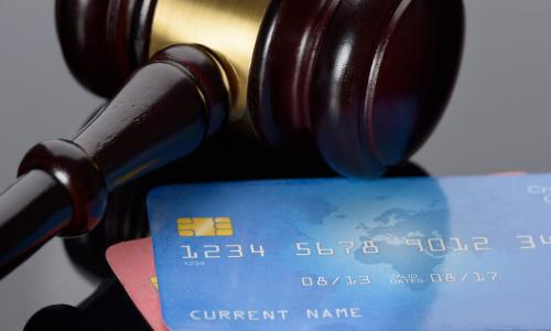 gavel with credit cards