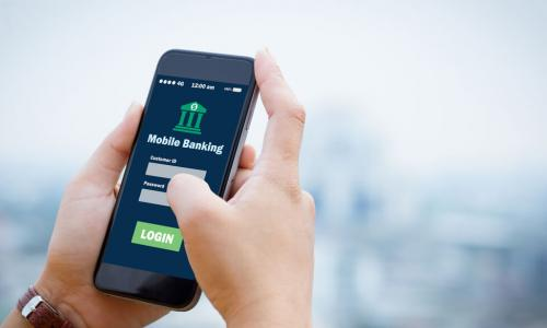 hands holding smartphone with mobile banking app login screen