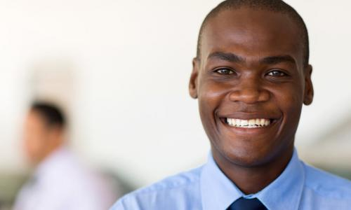 young black businessman smiling at camera