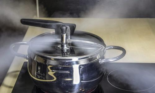 pressure cooker releasing hot steam