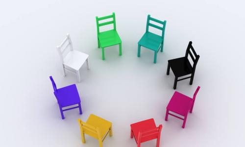 diversity illustrated through a circle of chairs of different colors