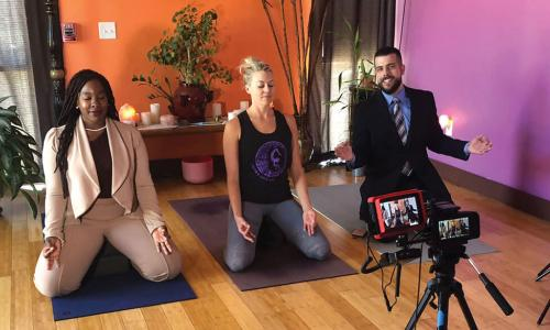 SAFE Credit Union employees doing yoga with local studio owner