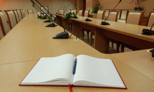 open notebook at a boardroom table