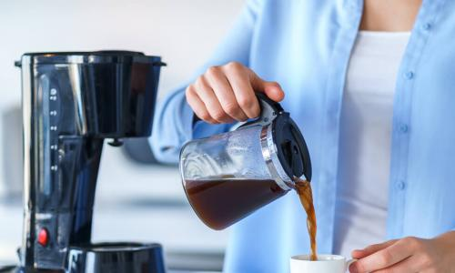 woman pouring morning coffee