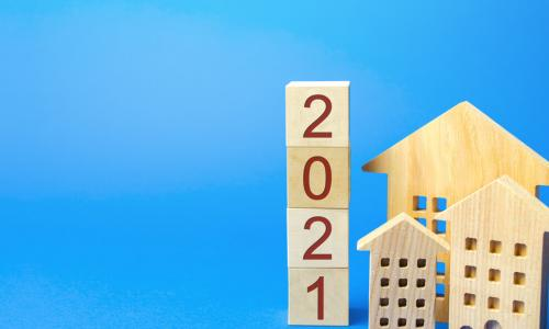 wooden blocks of houses and the year 2021