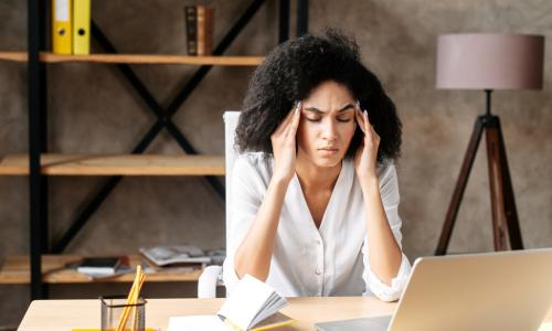 young Black professional woman feeling stressed